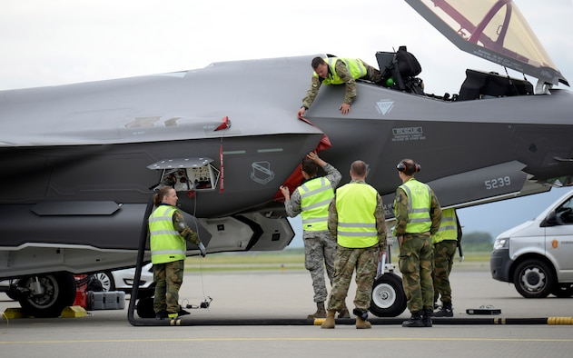 F-35 Lighting II maintainers from both the United States Air Force and Royal Norwegian Air Force work together at Orland Air Base, Norway, to turn two American jets after a sortie June 17, 2019. The visit marked the first time American F-35s have landed in Norway, which operates its own fleet of the fifth-generation fighters, and served as valuable training for the Norwegian maintainers. A fleet of F-35s is currently deployed to Europe as part of the European Deterrence Initiative, as as a way of proving the U.S. Air Force's ability to rapidly deploy fifth-generation fighters to European bases. (U.S. Air Force photo by Master Sgt. Austin M. May.)