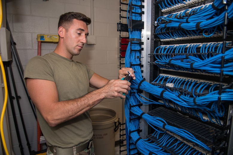 U.S. Air Force Tech. Sgt. Kenneth Overstreet, 178th Communications Squadron client systems from the Ohio Air National Guard, cuts a cable at Tyndall Air Force Base, Florida, June 18, 2019.