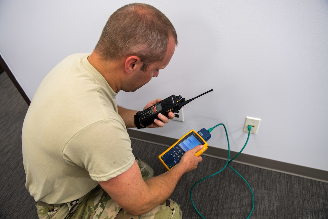 U.S. Air Force Master Sgt. Brian Lawrence, 178th Communications Squadron quality assurance NCO in charge from the Ohio Air National Guard, tests the ports for connectivity at Tyndall Air Force Base, Florida, June 18, 2019.