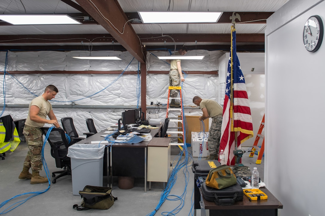 U.S. Air Force Airmen from the Ohio Air National Guard 178th Communications Squadron, install wires at Tyndall Air Force Base, Florida, June 18, 2019.
