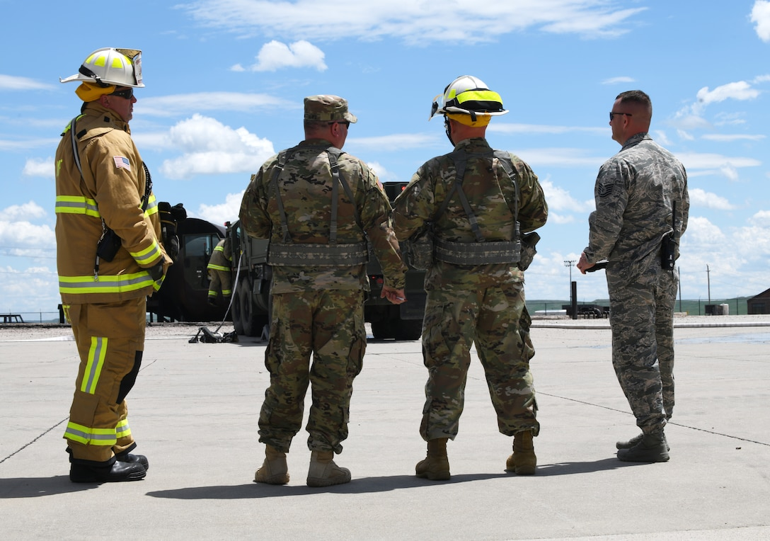 Ellsworth firefighters stand alongside firemen from South Dakota's Army National Guard prior to a training exercise at the fire pit on Ellsworth Air Force Base, S.D., June 12, 2019. Ellsworth AFB has one of the last few jet-fueled fire trainers, making the training experience more realistic. (U.S. Air Force photo by Airman 1st Class Christina Bennett)