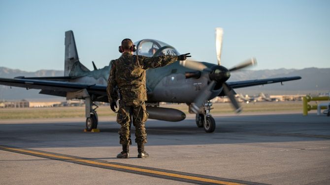 1st Sgt. DeBarros, a crew chief with the Brazilian Air Force, goes over pre-flight checks during Green Flag-West 19-8 at Nellis Air Force Base, Las Vegas, Nevada, June 8, 2019. The Brazilians and Idaho Air National Guard are supporting the 116th Cavalry Brigade Combat Team's National Training Center rotation at Fort Irwin, California. (U.S. Air National Guard photo by Master Sgt. Joshua C. Allmaras)