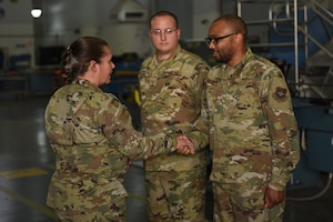 U.S. Air Force Brig. Gen. Linda Hurry, Defense Logistics Agency Aviation commander, left, recognizes Senior Airman Christopher Darrington, 60th Maintenance Squadron electrical and environmental systems journeyman, as a star performer June 17, 2019, at Travis Air Force Base, California. The general toured several units to learn firsthand about logistical operations and innovations at Travis. DLA Aviation is the combat logistics and supply chain manager for aviation and nuclear assets across the Department of Defense. (U.S. Air Force photo by Airman 1st Class Cameron Otte)