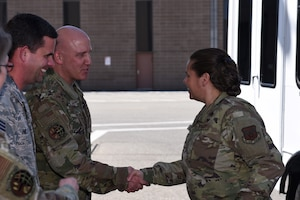 U.S. Air Force Brig. Gen. Linda Hurry, Defense Logistics Agency Aviation commander, is greeted by Chief Master Sgt. Brian Hilscher, 60th Aerial Port Squadron superintendent, and Chief Master Sgt. Scott Sikorski, 60th APS command chief, June 17, 2019, at Travis Air Force Base, California. The 60th APS showcased the mechanical material handling system and discussed how the system improve their ability to self-inventory and move pallets. DLA Aviation is the combat logistics and supply chain manager for aviation and nuclear assets across the Department of Defense. (U.S. Air Force photo by Airman 1st Class Cameron Otte)