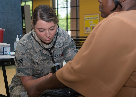 Senior Airman Kayla Katt, 103rd Airlift Wing aerospace medical technician, checks a patient's blood pressure during East Central Georgia Innovative Readiness Training at Louisville Academy, Louisville, Ga. June 19, 2019. East Central Georgia IRT is a civilian-military collaboration intended to build on mutually beneficial parnterships between U.S. communities and the Department of Defense to meet the training and readiness requirements for Active, Guard, and Reserve Service Members and units while addressing community health needs. (U.S. Air National Guard Photo by Staff Sgt. Steven Tucker)