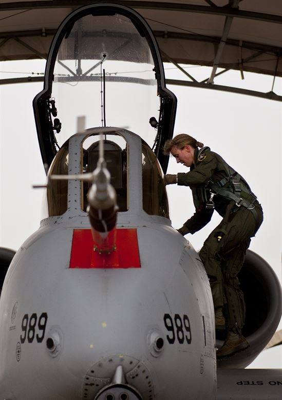Lt. Col. Olivia Elliott climbs up into an A-10 at Edwards AFB, California in 2013. Elliott is an A-10 pilot and currently enrolled at the Air Force Institute of Technology as part of the Advanced Academic Degree program working on her PhD in hypersonic aerodynamics. (Courtesy photo)