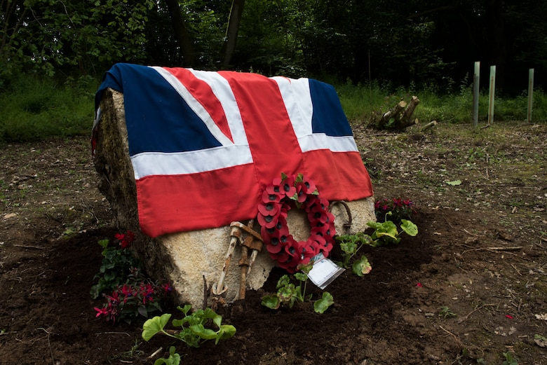 The Union Jack is draped over a Woodland Memorial stone June 9, 2019, in Ramsbury, U.K. The Woodland Memorial Service took place to honor all of those who gave their lives during the two World Wars and the servicemen currently serving in defense of our freedom. The ceremonial event was held to honor the sacrifices and strengthen the bond between the U.S. and U.K.