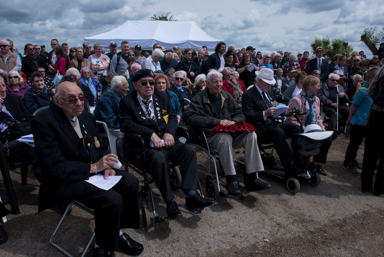 Members of the public, veterans and service members gather during the RAF Ramsbury Airfield Dedication ceremony June 9, 2019, at Ramsbury Airfield, U.K. The Remembrance Project brought veterans, Joint Base Charleston service members, RAF service members, and the public to this final ceremony. The ceremonial event was held to honor the sacrifices and strengthen the bond between the U.S. and UK. The final stage of this Airfield Remembrance Project coincides with the 75th anniversary of D-Day.