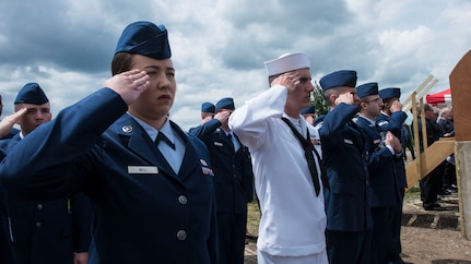 Senior Airman Summer Bell, 437th Maintenance munitions controller, salutes with service members from Joint Base Charleston, S.C., during the Royal Air Force Ramsbury Dedication ceremony, June 9, 2019, at Ramsbury Airfield, U.K. The ceremonial event was held to honor the sacrifices and strengthen the bond between the U.S. and U.K. The final stage of this Airfield Remembrance Project coincides with the 75th anniversary of D-Day.