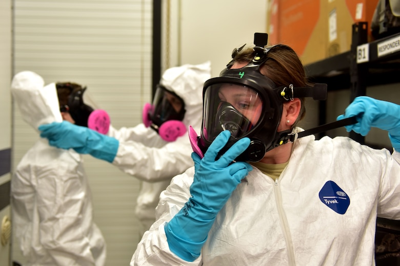 A woman puts on a protective mask.