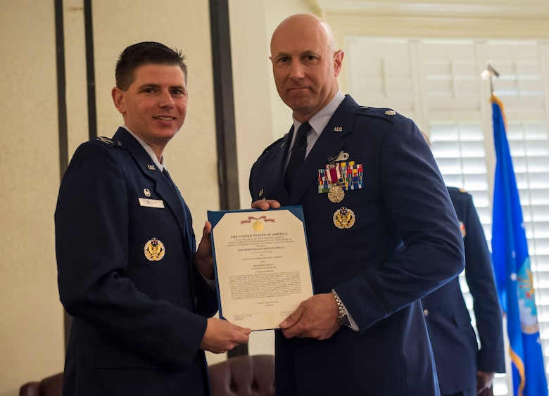 Col. Rockie Wilson, left, commander of the 628th Mission Support Group, presents the meritorious service medal to Lt. Col. William Parker, right, outgoing commander of the 628th FSS, during a change of command ceremony at the Charleston Club June 21, 2019, Joint Base Charleston, S.C. The 628th FSS is responsible for deploying services and personnel support teams, quality of life, professional and personal readiness, manpower and personnel services, food operations, lodging, fitness and leisure activities. Parker will be assuming a new role as the 628th MSG deputy commander.