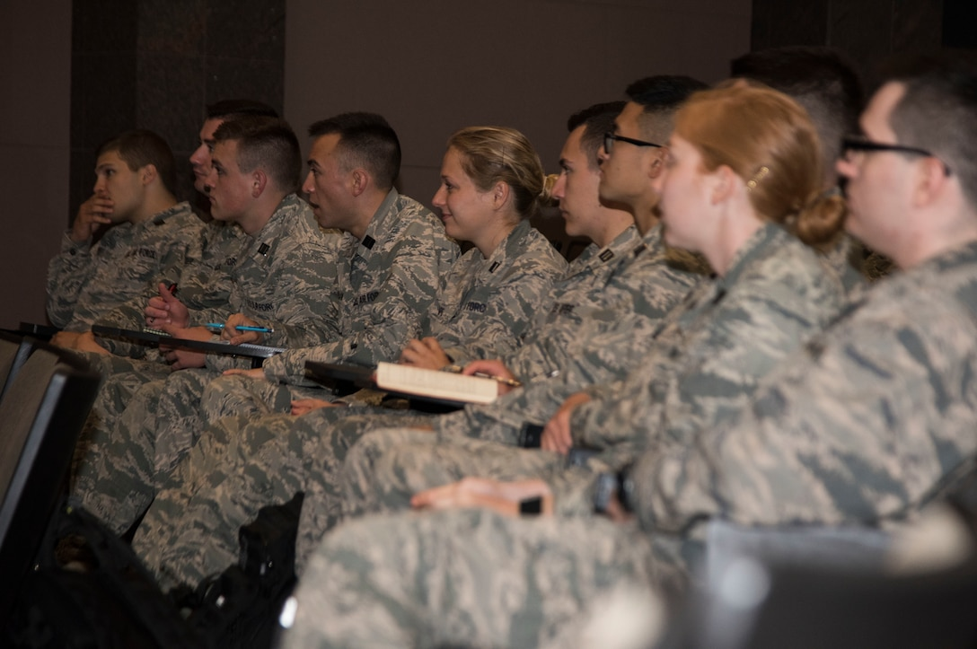Reserve Officer Training Corps cadets participate in a 30th Space Wing mission brief during the 2019 Space Cadre Program for ROTC cadets June 17, 2019, at Vandenberg Air Force Base, Calif.  The program allows select ROTC cadets to visit specific Air Force Space Command installations to get immersed in the command, learn about the base's specific mission, attend mission briefings, get senior leadership mentorship, and launch and satellite exposure with a focus on leadership and professional development. (U.S. Air Force photo by Airman 1st Class Hanah Abercrombie)