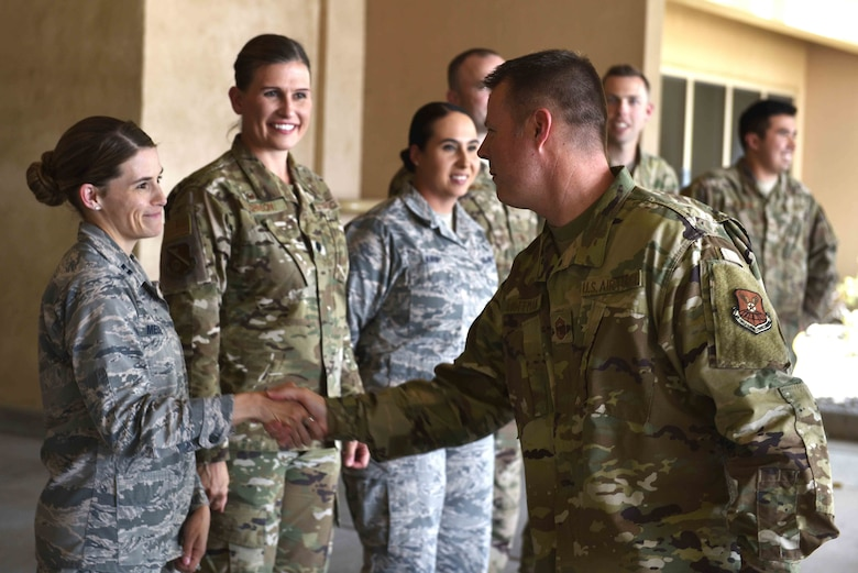 U.S. Air Force Chief Master Sgt. Charles Hoffman, Air Force Global Strike Command command chief, is welcomed by Capt. Malinda Meuse, flight commander, 377th Aerospace Medical Squadron war fighter clinic at Kirtland Air Force Base, N.M., June 13, 2019. Hoffman visited with Airmen across the 377th Air Base Wing to learn more about them and their mission. (U.S. Air Force photo by Airman 1st Class Austin J. Prisbrey)