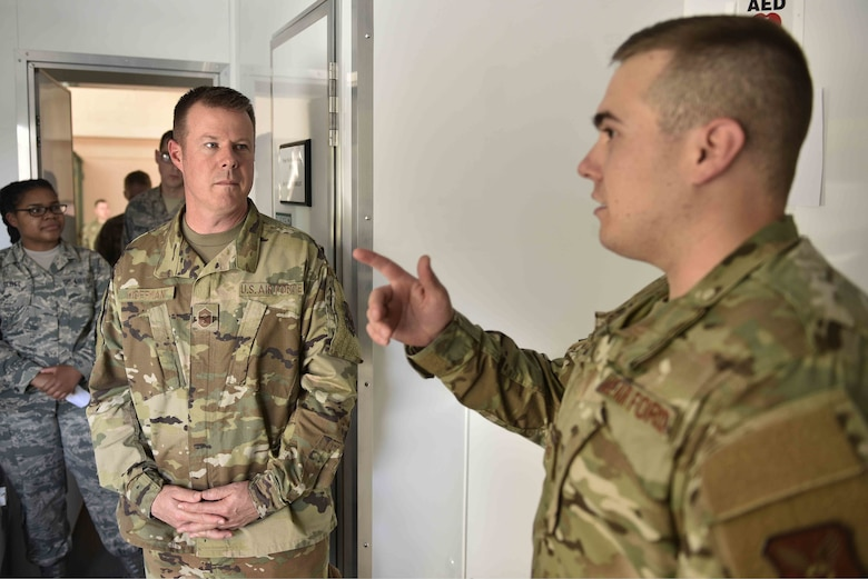 U.S. Air Force Chief Master Sgt. Charles Hoffman (left), Air Force Global Strike Command command chief, listens to Staff Sgt. Samuel Van Diest, non-commissioned officer in charge of medical logistics equipment, 377th Medical Support Squadron, talk about medical readiness at Kirtland Air Force Base, N.M., June 13, 2019. Hoffman visited with Airmen across the 377th Air Base Wing to learn more about them and their mission. (U.S. Air Force photo by Airman 1st Class Austin J. Prisbrey)