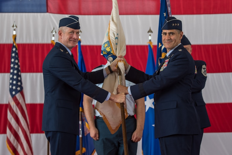 (Right) U.S. Air Force Lt. Gen. Marc Sasseville, commander, 1st Air Force (Air Forces Northern) and Continental U.S. North American Aerospace Defense Command Region (CONR) accepts the CONR guidon from Gen. Terrance O'Shaughnessy, commander, U.S. Northern Command and North American Aerospace Defense Command, during a change of command ceremony at Tyndall Air Force Base, Florida, June 20, 2019.