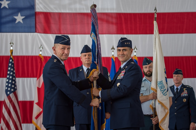 (Right) U.S. Air Force Lt. Gen. Marc Sasseville, commander, 1st Air Force (Air Forces Northern) and Continental U.S. North American Aerospace Defense Command Region (CONR) accepts the 1st AF guidon from Gen. Mike Holmes, commander, Air Combat Command, during a change of command ceremony at Tyndall Air Force Base, Florida, June 20, 2019.