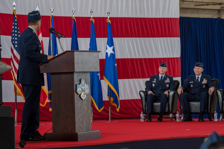 U.S. Air Force Lt. Gen. Marc Sasseville, commander, 1st Air Force (Air Forces Northern) and Continental U.S. North American Aerospace Defense Command Region (CONR) speaks words of appreciation to Gen. Terrance O'Shaughnessy, commander, U.S. Northern Command and North American Aerospace Defense Command, and Gen. Mike Holmes, commander, Air Combat Command, during a change of command ceremony at Tyndall Air Force Base, Florida, June 20, 2019.