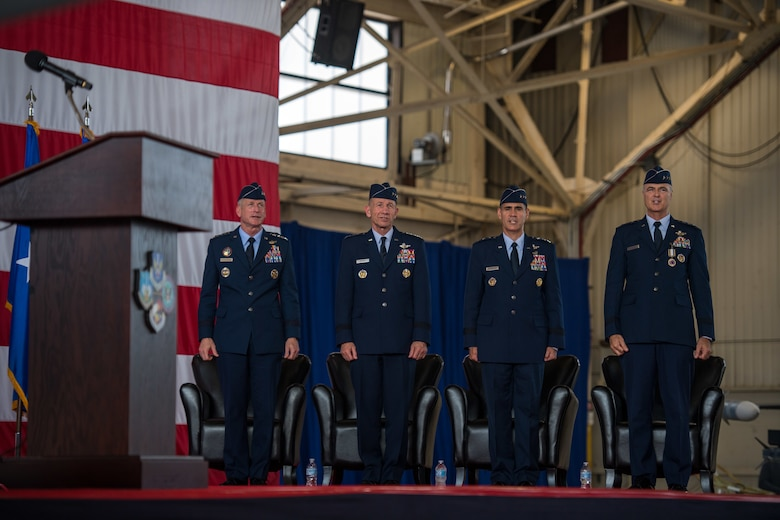 The official party for the 1st Air Force (Air Forces Northern) and Continental U.S. North American Aerospace Defense Command Region (CONR) Change of Command, sings the Air Force Song in culmination of the ceremony at Tyndall Air Force Base, Florida, June 20, 2019.