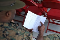 A Marine reads a pamphlet for the new power plant's ribbon cutting ceremony on Marine Corps Recruit Depot Parris Island, S.C. June 20, 2019. This new power plant will allow Parris Island to produce energy for its facilities independently. (U.S. Marine Corps photo by Lance Cpl. Ryan Hageali)