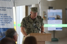 Public Works Officer Navy Cmdr. Andy Litteral speaks during a ceremony dedicated to the official opening of the depot's new power plant on Marine Corps Recruit Depot Parris Island, S.C. June 20, 2019. This new power plant will allow Parris Island to produce energy for its facilities independently. (U.S. Marine Corps photo by Lance Cpl. Ryan Hageali)