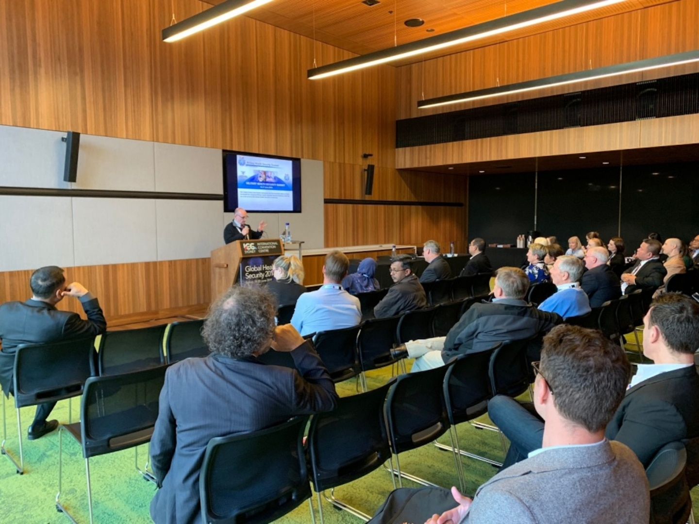 """CAMP SMITH (June 20, 2019) - U.S. Indo-Pacific Command (USINDOPACOM) Surgeon, Rear Adm. Louis C. Tripoli, speaks at the Global Health Security Conference in Sydney, Australia. The Conference caps off a nearly month long trip in which Tripoli participated in the Health and Humanitarian Actions in Emergencies Course, visited the Australian Defence Force Malaria and Infectious Disease Institute, , attended the World Health Organization event """"Scaling Up Country Health Emergency Preparedness"""" and co-hosted the Military Health Security Summit with the Australian Defence Force."""