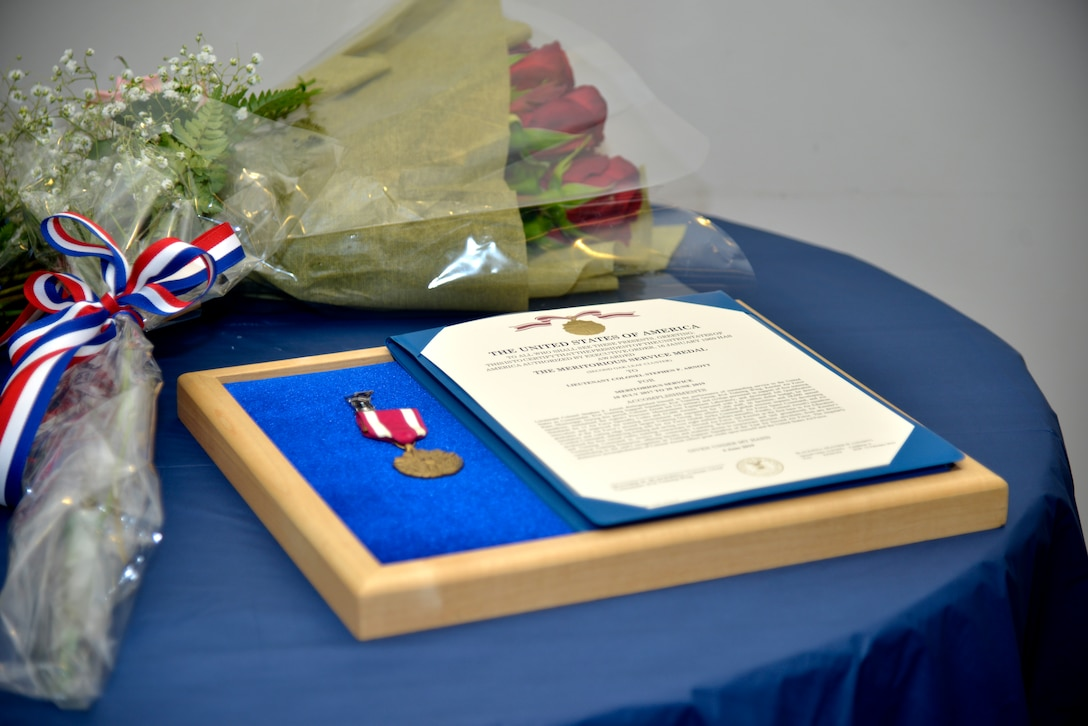 The Meritorious Service Medal is displayed at 81st Training Support Squadron change of command ceremony inside the Roberts Consolidated Aircraft Maintenance Facility on Keesler Air Force Base, Mississippi, June 20, 2019. Lt. Col. Elbert G. Mose, incoming 81st TRSS commander, assumed command from Lt. Col. Stephen Arnott with the passing of the guidon. The passing of the guidon is a ceremonial symbol of exchanging command from one commander to another. (U.S. Air Force photo by Airman Seth Haddix)