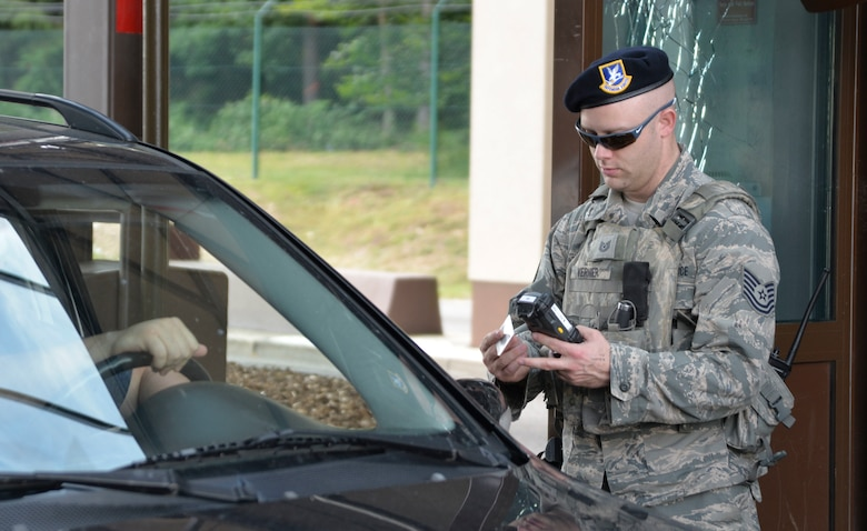 Airman ensures only authorized personnel are allowed access to the installation at Ramstein Air Base, Germany.