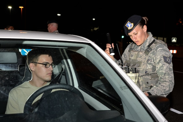 Airman conducts a night time random vehicle search on Ramstein Air Base, Germany.
