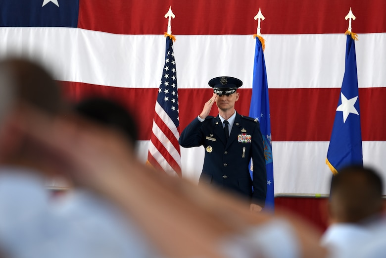 Col. David Miller, the new 377th Air Base Wing commander, receives his first salute from the Airmen of the 377th ABW during the change of command ceremony at Kirtland Air Force Base, N.M., June 21, 2019. Miller comes to Kirtland from Malmstrom AFB, Mont., where he was commander of the 341st Maintenance Group. (U.S. Air Force photo by Senior Airman Eli Chevalier)