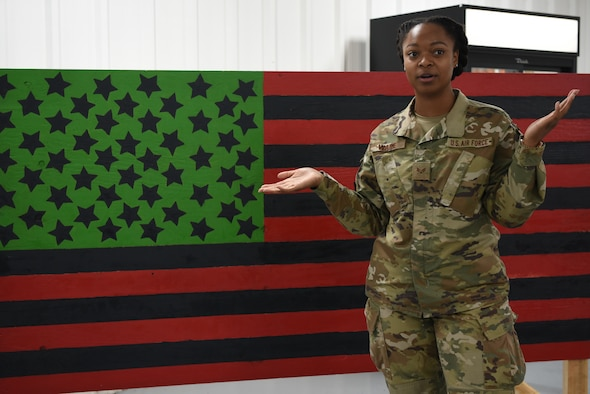 Senior Airman Hollye Ware, 380th Expeditionary Civil Engineer Squadron emergency management technician, kicks off the Juneteenth event by explaining the significance of the date in history at Al Dhafra Air Base, United Arab Emirates, June 19, 2019.