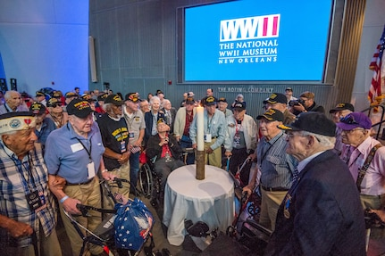 WWII veterans assemble around the Light of Remembrance candle at the National WWII Museum in New Orleans, La. on June 6, 2019.
