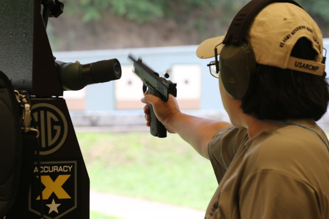 Staff Sgt. Sandra Uptagrafft (108th Training Command) firing at the 60th Annual Interservice Pistol Championship hosted and conducted by the U.S. Army Marksmanship Unit (USAMU) at Fort Benning.