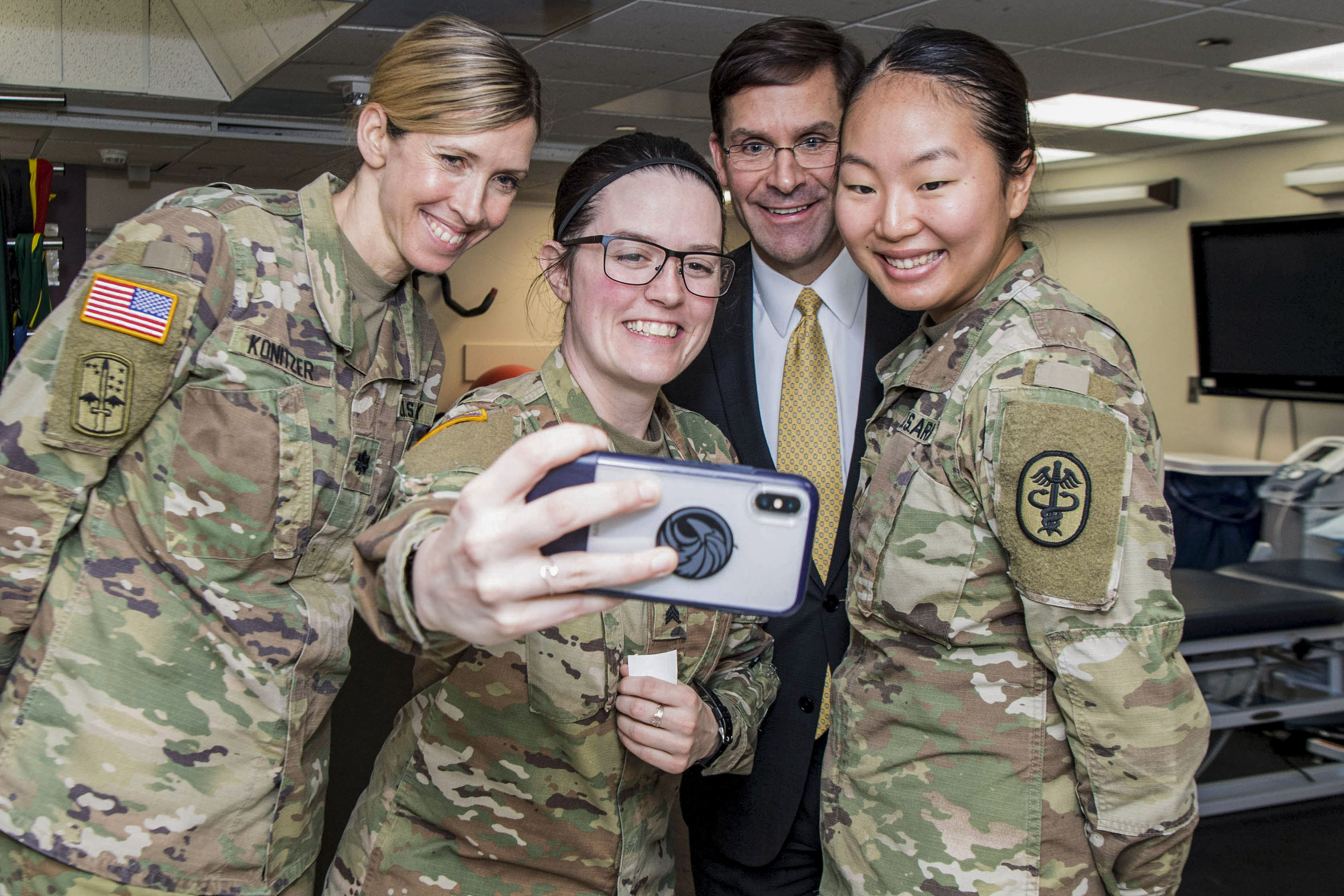 Army Secretary Mark Esper stands for a selfie with service members, March 14, 2019.