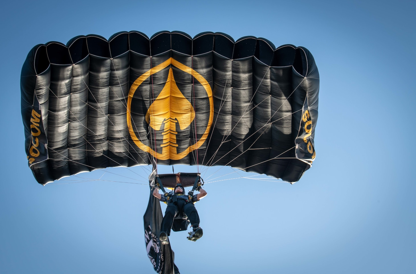 A member of the U.S. Special Operations Command parachute team lands from above at the 2019 DoD Warrior Games cycling time trials in Tampa, Florida.