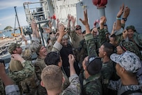 Royal Thai Navy and U.S. Coast Guardsmen celebrate after a visit, board, search, and seizure (VBSS) drill aboard the Quiandaohu-class auxiliary ship HTMS Similan (AOR 871) as part of Cooperation Afloat Readiness and Training (CARAT) Thailand 2019. (U.S. Navy photo by Mass Communication Specialist 2nd Class Joshua Mortensen)