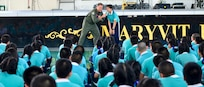 Rear Adm. Joey Tynch, commander, Task Force 73, speaks to students at Maryvit School during a community project as part of Cooperation Afloat Readiness and Training (CARAT) Thailand 2019. (U.S. Navy photo by Mass Communication Specialist 1st Class Greg Johnson)