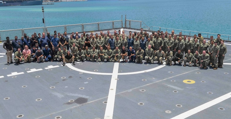 Multinational service members deployed as part of Pacific Partnership 2019 aboard the Military Sealift Command expeditionary fast transport ship USNS Brunswick (T-EPF 6) pose for a photo on the flight deck alongside Brunswick crew during Pacific Partnership 2019. (U.S. Navy photo by Mass Communication Specialist 3rd Class Chanel Turner)