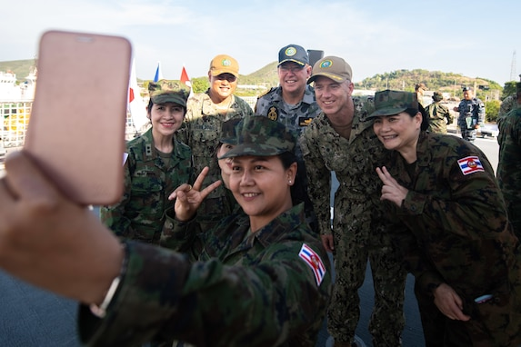 Members of the Royal Thai Armed Forces pose for a selfie with U.S. Navy Capt. Randy Van Rossum, Pacific Partnership 2019 (PP19) mission commander, Royal Australian Navy Capt. Brendon Zilko, PP19 chief of staff, and U.S. Navy Cdr. Edgar San Luis during the PP19 opening ceremony for Thailand. (U.S. Navy photo by Mass Communication Specialist 2nd Class Nicholas Burgains)