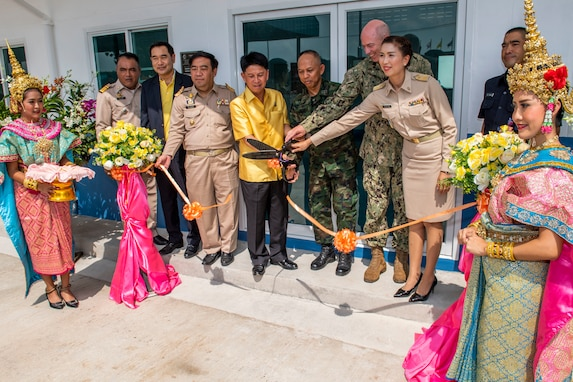Pacific Partnership 2019 (PP19) leaders cut a ribbon at a ceremony that marks the completion of a library, also designed to function as a shelter in the event of a natural disaster, constructed at Ban Surasak School by engineers from PP19 partner nations. (U.S. Navy photo by Mass Communication Specialist 1st Class Nathan Carpenter)