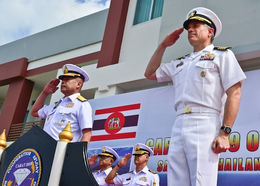 SATTAHIP NAVAL BASE, Thailand (May 29, 2019) - Capt. Matthew Jerbi, commodore of Destroyer Squadron 7, right, renders a salute alongside Royal Thai Navy Rear Adm. Paisarn Meesri, commander of Frigate Squadron 2, during the opening ceremony for Cooperation Afloat Readiness and Training (CARAT) Thailand 2019. (U.S. Navy photo by Mass Communication Specialist 1st Class Greg Johnson)