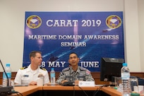 U.S. Navy Lt. Cmdr. Todd Hutchins, staff judge advocate assigned to Commander, Logistics Group Western Pacific, and Royal Thai Navy Capt. Yuthanavi Mungthanya, commanding officer of HTMS Bandpakong (FFG 456), participate in a maritime domain awareness seminar during Cooperation Afloat Readiness and Training (CARAT) Thailand 2019. (U.S. Navy photo by Mass Communications Specialist 2nd Class Corbin Shea)
