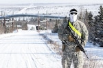 Spc. Roberto Terrazas, of the 220th Military Police Company, out of Colorado, maintains a checkpoint during Arctic Eagle 2018 at the Donnelly Training Area outside of Fort Greely, Alaska, Feb. 28, 2018. The National Guard, in partnership with active duty forces, local, state and federal agencies, can provide capabilities for homeland security and emergency response in the extreme cold-weather conditions of the Arctic region.