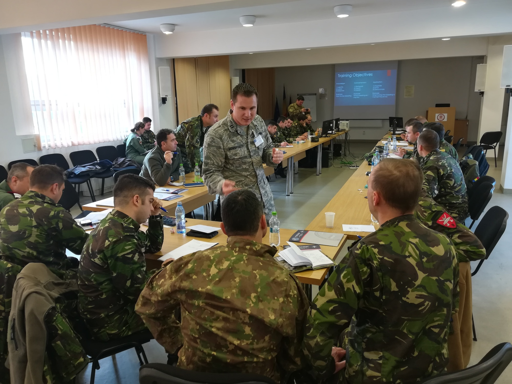 Then-Capt. Jason Mommaerts (center), U.S. Air Forces in Europe-Air Forces Africa International Health Specialist, teaches a class of 25 Romanian Land Forces medics on the different types of training objectives at a military medical center in Cluj Napoca, Romania, December 11, 2017. (U.S. Air Force photo by Col. Peter Vekszler)