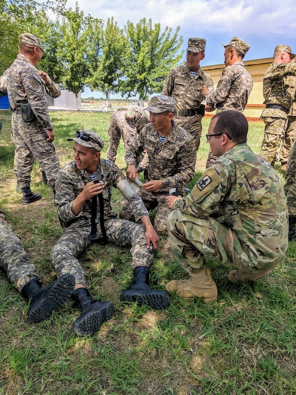 Soldiers with the U.S., Kazakhstani, and Kyrgyz Republic militaries practice bandaging and tourniquet techniques, June 19, 2019, during medical training at Steppe Eagle 19, at Illisky Training Area near Almaty, Kazakhstan. Steppe Eagle 19 is a U.S. Army Central-led exercise that promotes regional stability and interoperability in the Central and South Asia region.