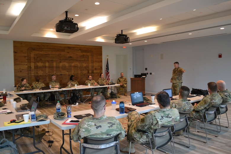 Brig. Gen. Aaron Walter, commander of the 100th Training Division-Leader Development, visits the officers attending the Command and General Staff College Phase Two 4x4 Course at Fort Belvoir, Virginia, June 10, 2019. The 4x4 course is a pilot program that allows Army officers to complete the second of three phases in person during four weekends instead of the previous option of eight weekend classes or through distance learning.