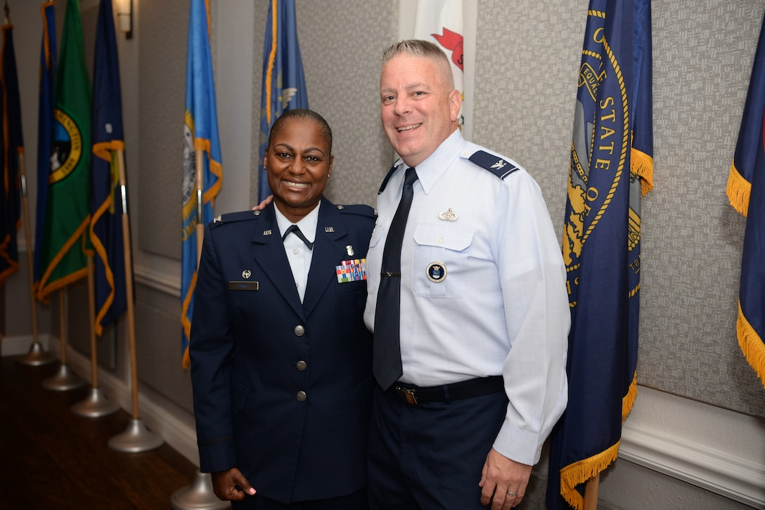 U.S. Air Force Col. Mary Parker, incoming 81st Inpatient Operations Squadron commander, and Retired Col. Robert Trayer, Parker's husband, pose for a photo inside the Don Wylie Auditorium on Keesler Air Force Base, Mississippi, June 21, 2019.