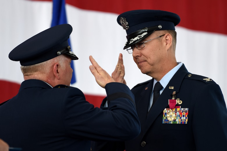 Col. Richard Gibbs, former 377th Air Base Wing commander, is awarded a Legion of Merit by Maj. Gen. Ferdinand B. Stoss III, 20th Air Force commander, during the 377th ABW Change of Command Ceremony at Kirtland Air Force Base, N.M., June 21, 2019. Gibbs, selected for brigadier general, will head to Air Mobility Command and Scott AFB, Ill., where he will become the A4 Director of Logistics, Engineering, and Force Protection. (U.S. Air Force photo by Senior Airman Eli Chevalier)