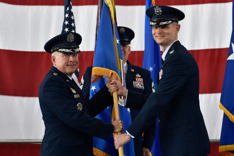Col. David Miller (right), incoming 377th Air Base Wing commander, receives the guidon and command of the 377th Air Base Wing from 20th Air Force Commander Maj. Gen. Ferdinand B. Stoss III in a ceremony June 21, 2019 at Kirtland Air Force Base. Stoss officiated the transfer of command from former commander Col. Richard Gibbs in a traditional change of command ceremony at Kirtland's Hangar 333. Miller comes to Kirtland from Malmstrom AFB, Mont., where he was commander of the 341st Maintenance Group. Gibbs, selected for brigadier general, is on his way to Air Mobility Command and Scott AFB, Ill., where he will become the Director of Logistics, Engineering, and Force Protection (A4). (U.S. Air Force photo by Airman 1st Class Austin J. Prisbrey)