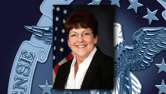 A portrait of Dorothy Lohr on a background featuring the DLA emblem