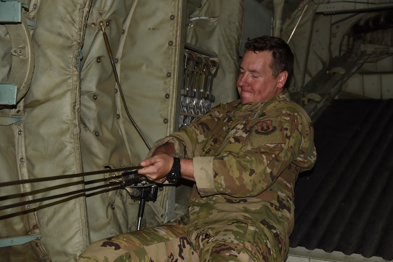 Tech. Sgt. Brandon Price, a loadmaster with the 815th Airlift Squadron, 403rd Wing, secures a static line cable in preparation for Army airborne units to use for their jump during exercise Swift Response 19, June 12, 2019. The exercise is one of the premier military crisis response training events featuring high readiness airborne forces from eight NATO nations. Activities include intermediate staging base operations, multiple airborne operations, and several air assault operations. The Swift Response exercises have had great success in creating a foundation for the strong relationships we share with several European allies and partners today. (U.S. Air Force photo by Master Sgt. Jessica Kendziorek)